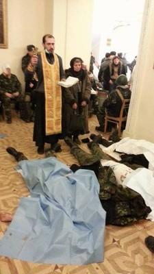 """Тела погибших в Доме офицеров. Фото: страница """"Евромайдана"""" на Фэйсбуке."""