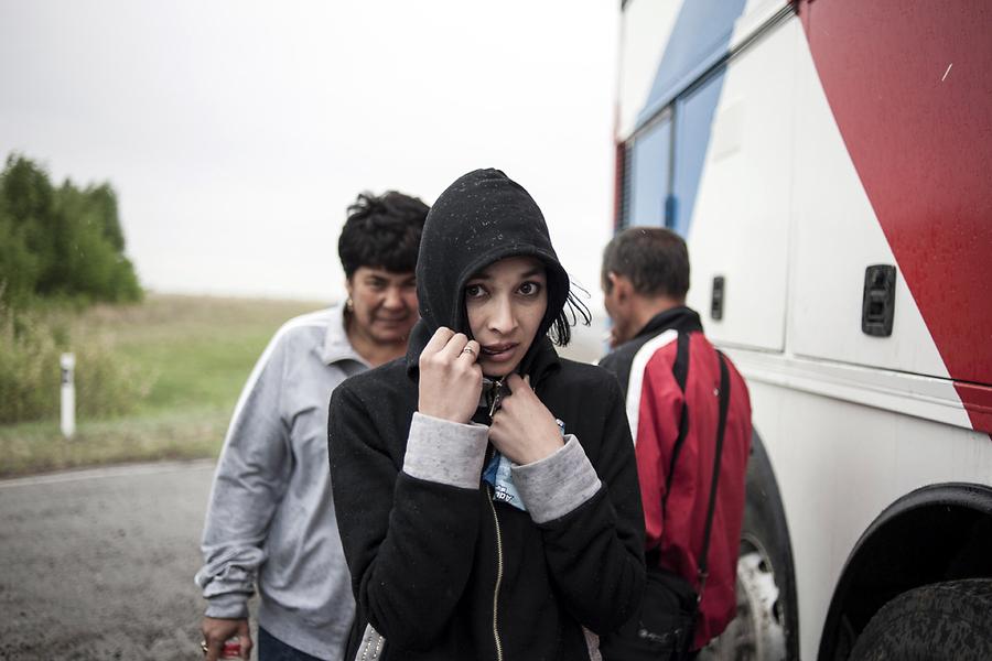 По пути в автобус подсели несколько женщин-трудовых мигранток, тоже направляющихся в Россию.