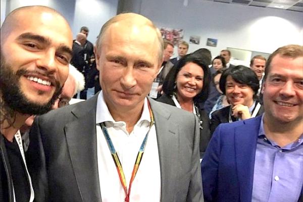 Президент России Владимир Путин, глава российского правительства Дмитрий Медведев и российский популярный исполнитель Тимати.