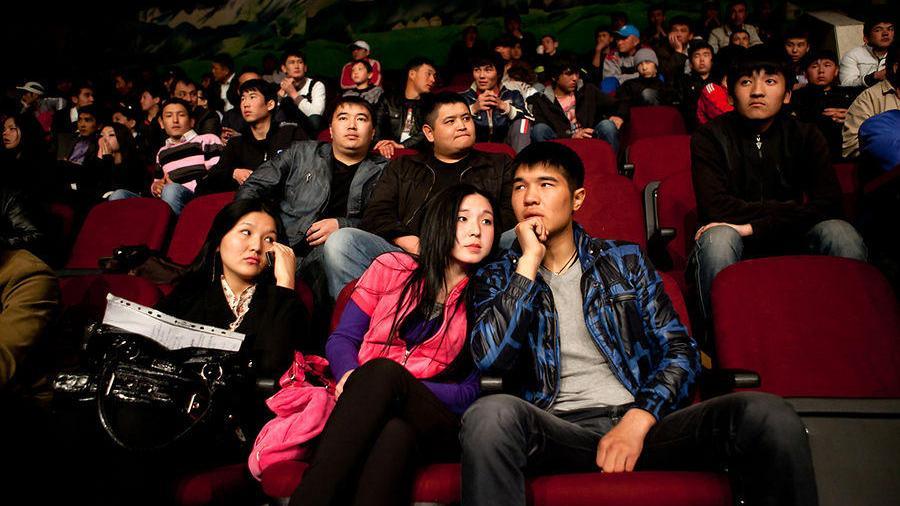 Young people watching a wrestling match, Bishkek, April 2011. David Trilling