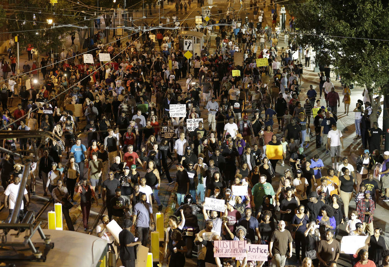 Демонстрация протеста. Фото: Chuck Burton/Associated Press