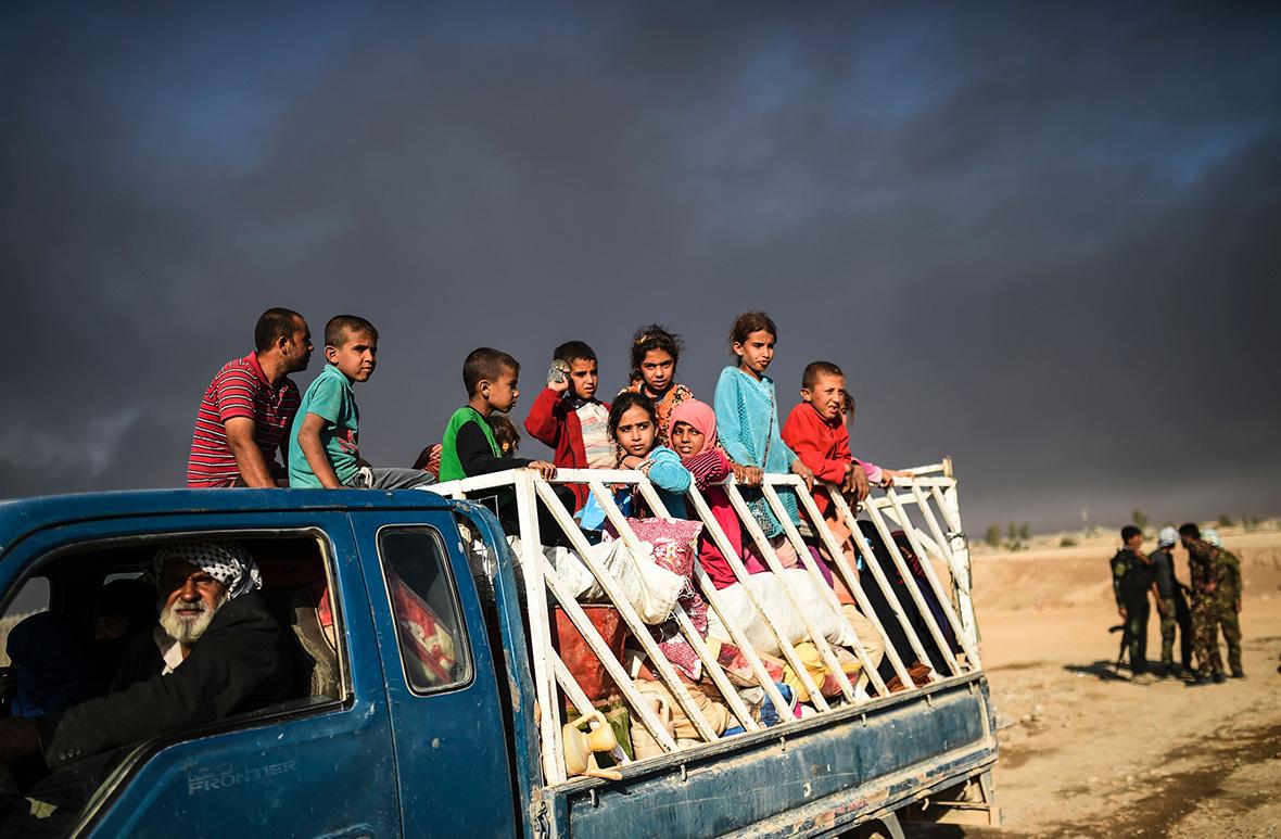 Дети-беженцы из Мосула. Фото: IBTimes UK.