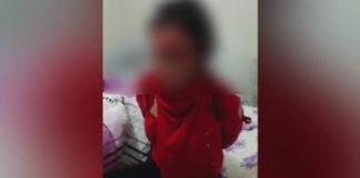 Избиение кыргызстанки. Скриншот из видео.